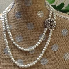 Handmade Beautiful double stranded pearl necklace. This is a handmade piece. Double strands of faux pearl with a single sided accent. Proudly made in Colorado Jewelry Necklaces