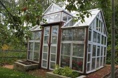 An elegant greenhouse made from old windows by sophia