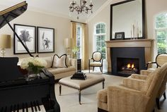 A newly conceptualized fireplace creates a dramatic focal point in this newly remodeled living room. The black limestone surround sets the mood for the coordinating black accents throughout the room. Marianne Jones LLC Marianne Jones - Birmingham, MI