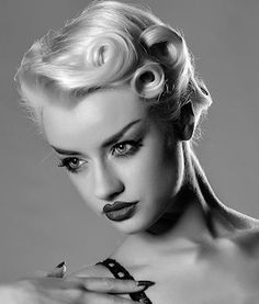 Pin curls looking great on a blonde, short design with a touch of the retro. - See more at: http://www.short-hairstyles.com/short/s1.htm