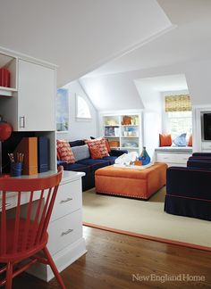 Whites & brights dominate a this third floor child study/media space... <3the navy & orange decor....