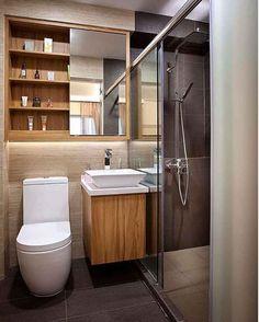 Banheiro pequeno, grandes ideias, ótimos resultados. Adorei o armário com portas de correr com espelho. O mix de revestimentos ficou muito interessante.