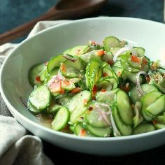 An easy to make Asian Cucumber Salad that's full of crunchy cucumber, rice wine vinegar, and a few secret ingredients! Can be served as a refreshing summer salad or the condiment to a sandwich!
