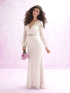 Classic brides and bohemian beauties alike will fall in love with this vintage patterned sleeved lace gown. MJ 112 at www.charlottesweddings.com