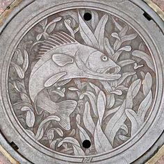 Walleye fish art manhole cover in Minneapolis, Minnesota