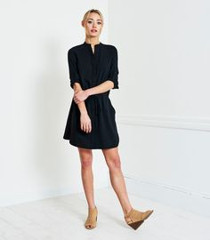 You won't feel buttoned up in over chic version of a closet staple, the Shirt Dress.This classic style flatters from...