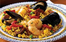 Vegetarian Paella in Dutch oven (Picture is not vegetarian, but recipe is and it's a good one)