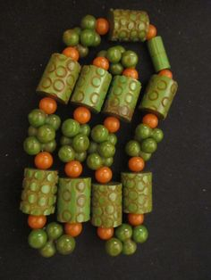 reminds me of  peas and carrots that we used to have at school when i was a kid.   Bakelite necklace