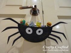 paper plate spider...spiders are creepy but this would be cool for Halloween candy holder at school.