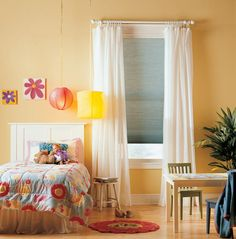 Add curtains over a cellular shade in the bedroom to soften harsh edges and block light that may seep through small gaps between the shade and the wall. Curtains Over Blinds, Long Curtains, Cafe Curtains, Budget Blinds, Cellular Shades, Custom Window Treatments, Girls Bedroom, Bedroom Ideas, Bedrooms