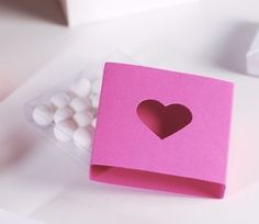 Romantic pink gift box with a cut-out heart - SelfPackaging