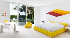 Lisa Perry-Master Bedroom, bed by Patricia Urquiola from B&B Italia, yellow chair is vintage Pierre Paulin, the desk is by Angelo Mangiarotti, the acrylic chair is by Philippe Starck for Kartell