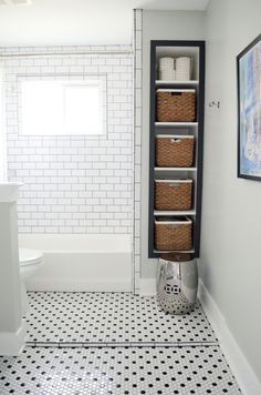 Built-In Bath Storage | Subway Tile Shower with Window | Black and White Hex Floor Tile