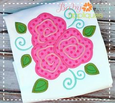 This elegant design features an easy to stitch flower trio surrounded by swirls and small leaves.