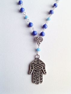 Hand of Fatima or Hamsa Necklace by Bluebirdsanddaisies on Etsy, £10.00