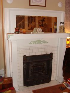 Craftsman Style Homes - My Old House Online I love the charm of the fireplace and the mirror above it.