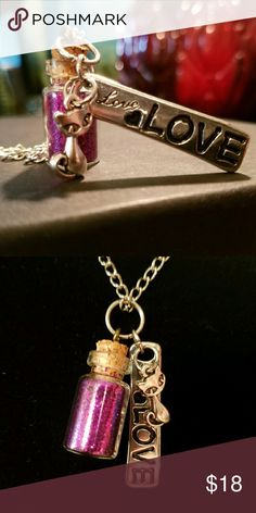 For the love of Cats Pixie Bottle Necklace Long stainless steel chain with tarnish resistant coating, designed as a pull over chain. Adorble pixie bottle filled purple glitter with a silver  cute kitty and long love charm.   Handmade by Magen's Fairytale Creations Magen's Fairytale Creations  Jewelry Necklaces