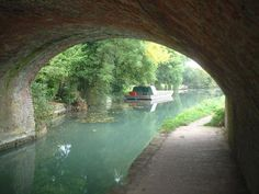 The Basingstoke Canal can be found in Southern England between the village of Greywell in Hampshire and Woodham in Surrey. It was built between 1788 and 1794 and is 32 miles long with 29 locks. After many years of restoration it's now fully navigable, and connects to the River Wey Navigation, which in turn joins the River Thames.