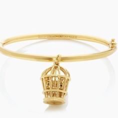 """Kate Spade Caged Love Birds Charm Bangle Bracelet Little love birds sit pretty inside the cage pendant on this lovely and whimsical Kate Spade Bangle  Features: Shiny 12k plated gold Inside engraved signature Kate Spade hinged closure. 2.5"""" Diameter Charm 1.5"""" Long x .75"""" Wide Comes with KSNY Jewelry Pouch kate spade Jewelry Bracelets"""