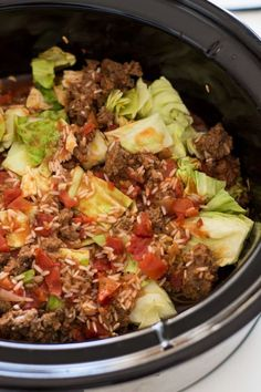 Eating Meals Crockpot This hearty and savory Crock Pot Cabbage Roll Casserole is cooked in a rich tomato sauce, full cabbage, beef and herbs! Super easy to make, this Crock Pot Cabbage Roll Casserole makes for a perfect weeknight meal! Crockpot Cabbage Recipes, Crock Pot Cabbage, Crockpot Dishes, Crock Pot Slow Cooker, Slow Cooker Recipes, Beef Recipes, Cooking Recipes, Crockpot Unstuffed Cabbage Rolls, Crockpot Cabbage Roll Soup