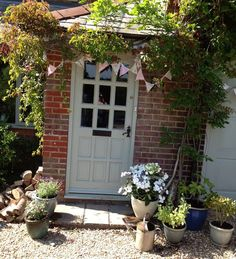 Modern Country Style: Case Study: Farrow and Ball Green Blue painted front door Click through for details.