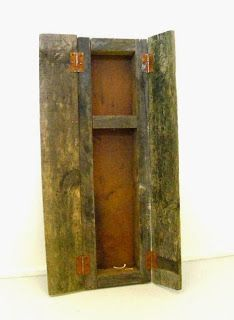 Andrew McDonald Artist What Remains... Mixed media : Cupboard constructed from found wood and metal containing broken chicken wishbone