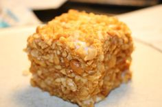 Peanut Square-- White cake drenched in white powered sugar frosting & covered in crushed peanuts