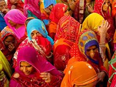 Photo Credit: Antonino Puppi Bridal Procession Women in bright saris crowd together as they walk in a bridal procession in Mandawa, Rajasthan. Rajasthan is the largest state in India—a land of extremes—encompassing steamy forests, dry plains, and the snowy Himalaya. http://travel.nationalgeographic.com/travel/countries/india-photos/#/bridal-procession_6015_600x450.jpg