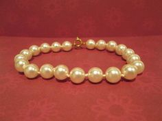 Hey, I found this really awesome Etsy listing at https://www.etsy.com/listing/198602675/vintage-white-faux-pearl-bracelet-8