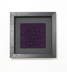 Framed textile by Ruth Singer