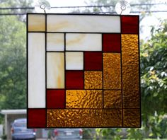 I made this beautiful Log Cabin Quilt stained glass panel using amber textured glass and a streaky amber white glass.