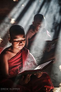 Seeking Enlightenment - Two novice monks reciting passages inside a quiet temple in Old Bagan, Myanmar. Live Action, Buddha, Avatar, Narrative Photography, Buddhist Monk, Archangel Michael, People Of The World, World Cultures, Geometric Tattoos