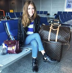Chiara Ferragni of The Blonde Salad in a striped sweater, moto jacket, and black boots