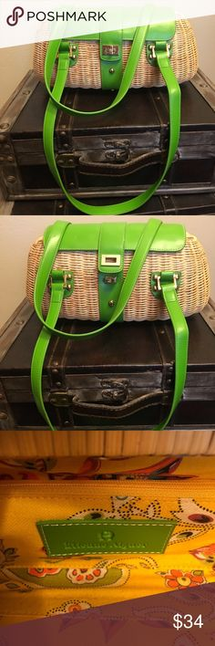 Etienne Aigner purse Etienne  Aigner very cute purse, 100% natural rattan with manmade trim, in excellent condition. Very stylish, you will stand out in any crowd with this cutie. Etienne Aigner Bags