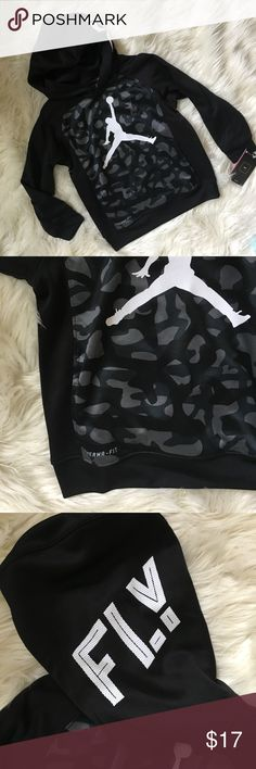 "NWT Nike boys hoodie New with tags boys Nike Jordan black and grey hoodie size 6/7. Says FLY on hood. Therma fit. Armpit to armpit is 16"". Top of shoulder to bottom of sweatshirt is 18 1/2"". Sleeves are 15"" Nike Shirts & Tops Sweatshirts & Hoodies"