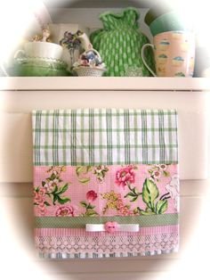 Decorate your shabby kitchen with lots of greens and pinks. I have hung this gorgeous decorative tea towel over a cabinet door. Creates a pretty effect. Created by Cath.
