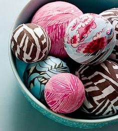 This is a great way to use up fabric remnants to create pretty decorations. Glue strips of fabric in various colors and patterns to different size foam balls.