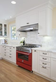 Red Stove, subway tile, wood floor...stunning
