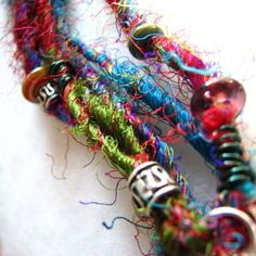 Gypsy Dancer - bracelet, silk, glass, base metals, copper, multi-stranded  sold by me in August 2008, $12 on etsy.  I should make more.