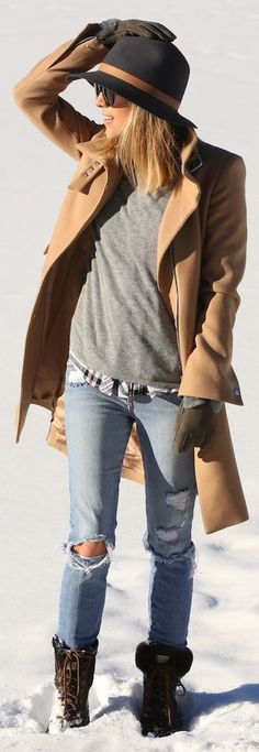 Maybe not holey jeans in the snow, but cute outfit.  I like the layering and the boots.