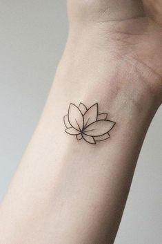 Tattoos 53 Best Lotus Flower Tattoo Ideas To Express Yourself Simple Tiny Wrist Lotus Tattoo Lotus Tattoo Design, Lotus Tattoo Wrist, Simple Lotus Flower Tattoo, Small Flower Tattoos, Flower Tattoo Designs, Compass Tattoo, Small Tattoos, Lotus Design, Tiny Lotus Tattoo