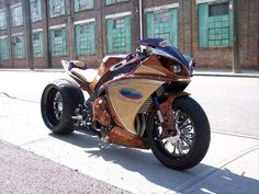 customized Yamaha YZF-R1 is a collaboration between American rapper T.I. AKOO's clothing brand and custom sportbike designer and builder Rob Uecker of Voodoo Industries.  Dubbed the AKOO YZF-R1, the bike sports a wooden veneer paint job mixed with what looks like Alcantara or suede on the side