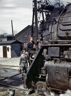 """Marcella Hart and Viola Sievers work as wipers with the Chicago and North Western Railroad and are seen about to clean one of the giant """"H"""" class locomotives in Clinton, Iowa. (Photo Credit: Jack Delano/Library of Congress/History By Zim) Volkswagen, Porto Rico, Underground Bunker, Old Trains, Vintage Trains, American War, Steam Locomotive, Model Trains, World War Ii"""