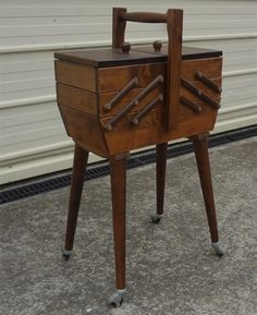 Cantilevered sewing box on wheels.