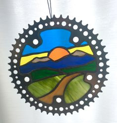 stained glass mountain and trail in recycled bicycle chain ring,https://www.etsy.com/shop/NightShiftGlass Stained Glass Designs, Mosaic Designs, Mosaic Ideas, Stained Glass Projects, Stained Glass Art, Mosaic Glass, Fused Glass, Bicycle Wheel, Bicycle Art