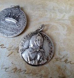 Hey, I found this really awesome Etsy listing at https://www.etsy.com/listing/176915299/vintage-st-marguerite-bourgeoys-medal