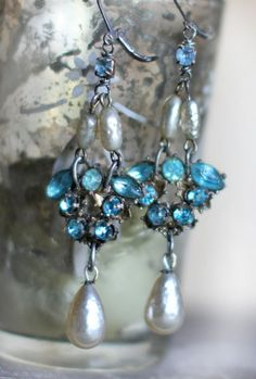 Old vintage clip on earrings from the art deco period, are now dazzling dangling earrings. Prong-set aquamarine rhinestones, gorgeous drops (most