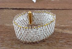Peyote Stitch Bracelet with Gold Lined Fringe by AriGarDesigns