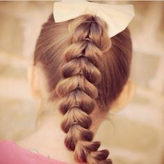 A great sporty hairdo, the pull through ponytail braid!