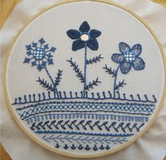 Flower Sampler by TroubleT. Wow. This is amazing. I would break my no hoopla rule for this. I love the flowers. Would be even better in pink (everything is better in pink, lol)